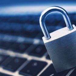 Data Security Encryption Photo Concept with Metallic Padlock on Laptop Computer Keyboard.